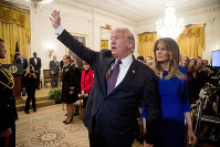 In this Nov. 16, 2018, photo, first lady Melania Trump walks with President Donald Trump as they leave a Medal of Freedom ceremony in the East Room of the White House in Washington, on Nov. 16, 2018. (AP Photo/Andrew Harnik)