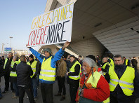 Demonstrators gather to protest fuel taxes in Paris, France, on Nov. 17, 2018. Placard reads, yellow jacket black anger. (AP Photo/Michel Euler)