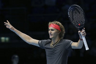 Alexander Zverev of Germany celebrates winning match point against John Isner of the United States in their ATP World Tour Finals singles tennis match at the O2 Arena in London, on Nov. 16, 2018. (AP Photo/Tim Ireland)