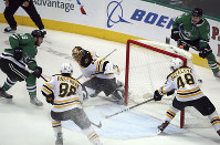 Dallas Stars center Jason Dickinson (16) scores the winning goal against Boston Bruins goaltender Tuukka Rask (40) in overtime in an NHL hockey game on Nov. 16, 2018, in Dallas. (AP Photo/Richard W. Rodriguez)