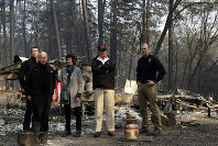 President Donald Trump talks with from left, Gov.-elect Gavin Newsom, California Gov. Jerry Brown, Paradise Mayor Jody Jones and FEMA Administrator Brock Longduring a visit to a neighborhood destroyed by the wildfires, on Nov. 17, 2018, in Paradise, Calif. (AP Photo/Evan Vucci)