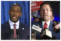 This combination of November 2018 photo shows Andrew Gillum, left, the Democratic candidate for governor, and Republican candidate Ron DeSantis.  (AP Photo/Steve Cannon, Phelan M. Ebenhack)