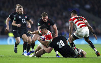 Japan's Ryoto Nakamura, centre left, is tackled by England's Sam Underhill during the rugby union international match between England and Japan at Twickenham Stadium, London, on Nov. 17, 2018. (Andrew Matthews, PA via AP)