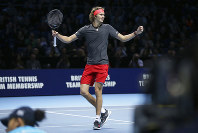 Alexander Zverev of Germany celebrates winning match point against Roger Federer of Switzerland in their ATP World Tour Finals singles tennis match at the O2 Arena in London, on Nov. 17, 2018. (AP Photo/Tim Ireland)