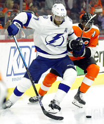 Tampa Bay Lightning' Victor Hedman, left, holds on to the stick of Philadelphia Flyers' Wayne Simmonds during the second period of an NHL hockey game, on Nov. 17, 2018, in Philadelphia. Hedman got a two-minute penalty. (AP Photo/Tom Mihalek)