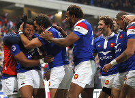 French rugby players celebrate after France's Teddy Thomas, left, scored a try during their rugby union international match between France and Argentina at the Pierre Mauroy stadium, in Lille, northern France, on Nov. 17, 2018. (AP Photo/Christophe Ena)