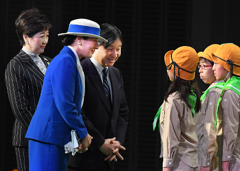 Crown Prince Naruhito, third from left, and Crown Princess Masako, second from left, talk to children at the