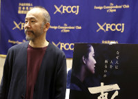 In this Nov. 7, 2018, photo, Japanese director Shinya Tsukamoto speaks to reporters about his latest film