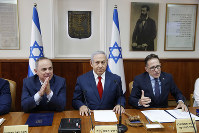 Israeli Prime Minister Benjamin Netanyahu, center, Government Secretary Tzahi Braverman, center right, Yuval Steinitz Israel's Minister of Energy, center left, in charge of Israel Atomic Energy Commission attend the weekly cabinet meeting at the prime minister's office in Jerusalem, on Nov. 18, 2018. (Abir Sultan/Pool via AP)