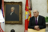 White House Chief of Staff John Kelly watches as President Donald Trump speaks during a signing ceremony for the