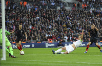 England's Harry Kane, 2nd right, scores his side's second goal during the UEFA Nations League soccer match between England and Croatia at Wembley stadium in London, on Nov. 18, 2018. (AP Photo/Rui Vieira)