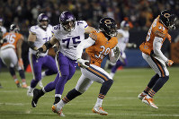 Chicago Bears safety Adrian Amos (38) runs past Minnesota Vikings offensive tackle Brian O'Neill (75) after intercepting a pass during the first half of an NFL football game on Nov. 18, 2018, in Chicago. (AP Photo/Nam Y. Huh)