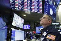 Trader Anthony Rinaldi follows stock activity on Nov. 19, 2018, at the New York Stock Exchange. (AP Photo/Mark Lennihan)