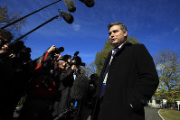 CNN's Jim Acosta speaks to journalists on the North Lawn upon returning back to the White House in Washington, on Nov. 16, 2018. (AP Photo/Manuel Balce Ceneta)