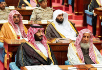 In this photo provided by the Saudi Press Agency, Saudi King Salman gives his annual policy speech in the ornate hall of the consultative Shura Council in Riyadh, Saudi Arabia, on Nov. 19, 2018. (AP Photo/Saudi Press Agency)