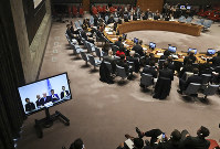 United Nations chief mediator for Syria, Staffan de Mistura, shown center in a live video broadcast, briefs the U.N. Security Council on Nov. 19, 2018, at U.N. headquarters. (AP Photo/Bebeto Matthews)