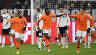 The Netherlands' Quincy Promes, center, celebrates after scoring his side's first goal during the UEFA Nations League soccer match between Germany and The Netherlands in Gelsenkirchen, Germany, on Nov. 19, 2018. (AP Photo/Martin Meissner)