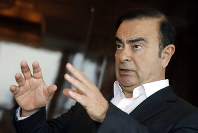 In this Friday, April 20, 2018 photo, Nissan Chairman Carlos Ghosn speaks during an interview in Hong Kong. (AP Photo/Kin Cheung)