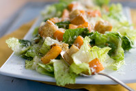 This Jan. 24, 2012, file photo shows a Caesar salad with romaine lettuce. Food regulators are urging Americans not to eat any romaine lettuce because of a new food poisoning outbreak. (AP Photo/Matthew Mead)