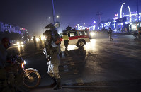 Security forces block the roads at the site of a suicide attack in Kabul, Afghanistan, on Nov. 20, 2018. (AP Photo/Massoud Hossaini)