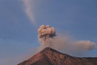 The Volcan de Fuego, or Volcano of Fire, spews a plume of ash as seen from San Juan Alotenango, Guatemala, on Nov. 20, 2018. (AP Photo/Moises Castillo)