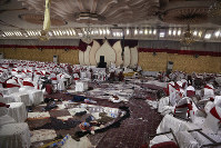 Inside of a wedding hall in Kabul, Afghanistan, is seen on Nov. 21, 2018, a day after a suicide attack. (AP Photo/Rahmat Gul)