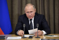 Russian President Vladimir Putin speaks during a meeting with officials in the Bocharov Ruchei residence in the Black Sea resort of Sochi, Russia, on Nov. 21, 2018. (Alexei Nikolsky, Sputnik, Kremlin Pool Photo via AP)