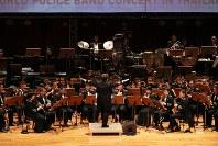 「第23回世界のお巡りさんコンサートinタイ」。レベルの高い演奏で観客を魅了した警視庁音楽隊=タイ・バンコクで2018年11月25日午後、松田嘉徳撮影