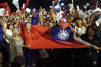 In this Nov. 24, 2018 photo, supporters of the opposition Nationalist Party cheer in Kaohsiung, Taiwan. (AP Photo)