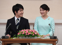 Princess Mako, right, and Kei Komuro are pictured at a news conference on their engagement at Akasaka Estate in the Motoakasaka district of Tokyo, on the afternoon of Sept. 3, 2017. (Pool photo)