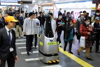 A security robot equipped with artificial intelligence patrols at the premises of Seibu-Shinjuku Station in Tokyo's Shinjuku Ward on Nov. 29, 2018. (Mainichi/Yuki Miyatake)