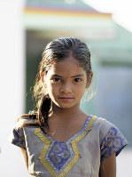 「あなたと、わたし」の表紙となった、インド・テランガナ州の村で出会った少女。真っすぐな彼女の視線が、私の中でサヘルさんの目と重なった。