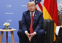 U.S. President Donald Trump listens to questions from members of the media during his meeting with Germany's Chancellor Angela Merkel at the G-20 Summit, on Dec. 1, 2018, in Buenos Aires, Argentina. (AP Photo/Pablo Martinez Monsivais)