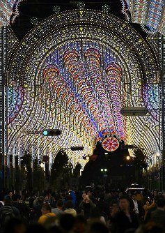 Visitors take photos of displays lit up for a test run ahead of Kobe Luminarie in the city's Chuo Ward, Hyogo Prefecture, on Dec. 3, 2018. (Mainichi/Rei Kubo)