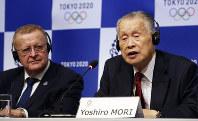 Tokyo 2020 President Yoshiro Mori, right, speaks as Head of the IOC inspection team John Coates listens during a press conference in Tokyo, on Dec. 5, 2018. (AP Photo/Koji Sasahara)