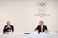 International Olympic Committee (IOC) President Thomas Bach, right, gestures to John Coates, left, chairman of the IOC Coordination Commission for the 2020 Tokyo Olympics and Paralympics, prior to an IOC Executive Board meeting on Dec. 1, 2018, in Tokyo. (AP Photo/Eugene Hoshiko)