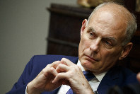 In this June 21, 2018 photo, White House chief of staff John Kelly listens as President Donald Trump speaks during a lunch with governors in the Roosevelt Room of the White House in Washington. (AP Photo/Evan Vucci)