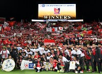 Urawa Reds players and other staff members take photos with supporters as they celebrate winning the Emperor's Cup after beating Vegalta Sendai at Saitama Stadium in the city of Saitama, northern Tokyo, on Dec. 9, 2018. (Mainichi/Toshiki Miyama)