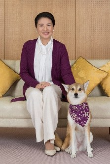In this Dec. 4, 2018 photo provided by the Imperial Household Agency, Crown Princess Masako is seen with her pet dog Yuri at the Togu Palace at the Akasaka Estate in Tokyo ahead of her 55th birthday.