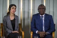 Nobel peace price laureates Nadia Murad, left, and Dr. Denis Mukwege look on during the press conference at the Nobelinstituttet in Oslo, on Dec. 9, 2018. (Heiko Junge/NTB scanpix via AP)