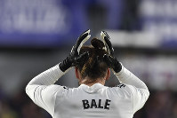 Real Madrid's Gareth Bale, adjusts his hair during the Spanish La Liga soccer match between Real Madrid and SD Huesca at El Alcoraz stadium, in Huesca, northern Spain, on Dec. 9, 2018. Real Madrid won 1-0. (AP Photo/Alvaro Barrientos)