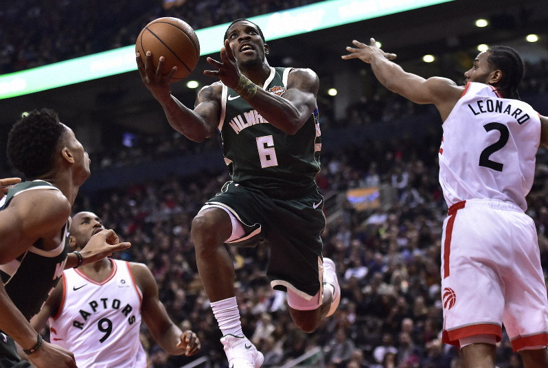 Milwaukee Bucks Guard Eric Bledsoe 6 Drives To The Net As Toronto Raptors Forward Kawhi Leonard 2 Attempts Defend During First Half NBA Basketball