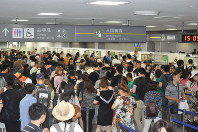 In this July 9, 2018 file photo, foreign visitors line up at immigration control at Narita International Airport in Narita, Chiba Prefecture, east of Tokyo. (Mainichi/Tadakazu Nakamura)