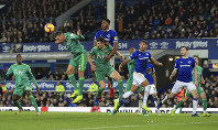 Watford's Jose Holebas heads the ball during the English Premier League soccer match against Everton at Goodison Park in Liverpool, Britain, on Dec. 10, 2018. (Peter Byrne/PA via AP)