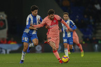 FC Barcelona's Lionel Messi, center, controls the ball during the Spanish La Liga soccer match between Espanyol and FC Barcelona at RCDE stadium in Cornella Llobregat, Spain, on Dec. 8, 2018. (AP Photo/Joan Monfort)