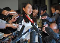 Figure skater Rika Kihira speaks to reporters at Narita International Airport in the city of Narita, Chiba Prefecture, on Dec. 11, 2018, upon her return to Japan after she won the Grand Prix of Figure Skating Final in Vancouver. (Mainichi/Koichiro Tezuka)
