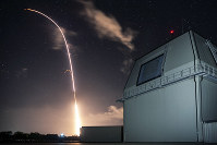 This Dec. 10, 2018 photo provided by the U.S. Missile Defense Agency (MDA) shows the launch of the U.S. military's land-based Aegis missile defense testing system, that later intercepted an intermediate range ballistic missile, taken from the Pacific Missile Range Facility on the island of Kauai in Hawaii. (Mark Wright/Missile Defense Agency via AP)