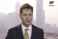 In this image made from a video taken on March 28, 2018, Michael Kovrig, an adviser with the International Crisis Group, a Brussels-based non-governmental organization, speaks during an interview in Hong Kong. (AP Photo)