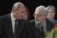 Russian President Vladimir Putin, left, speaks to Lyudmila Alexeyeva's son Professor of Economics at Indiana University, Mikhail Alekseev, he comes to pays his last respects to Lyudmila Alexeyeva, the Moscow Helsinki Group Chair and human rights activist during a farewell ceremony in Moscow, Russia, on Dec. 11, 2018. (Alexei Druzhinin, Sputnik, Kremlin Pool Photo via AP)