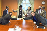 Abdelqader al-Murtada and Saelem Mohammed Noman Al-Mughalles, at left, representatives of the Houthi rebels delegation and to the right, Askar Zaeil and Hadi al-Hayi representing the delegation of the Government of Yemen together with representatives from the office of the UN Special Envoy for Yemen and the International Red Cross Committee (ICRC) during the ongoing peace talks on Yemen held at Johannesberg Castle, in Rimbo, Sweden, on December 11, 2018. (Claudio Bresciani/TT via AP)